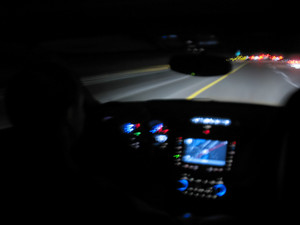 Driving at night time in a modern luxury vehicle.