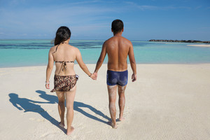 Asian couple enjoying summer on beach