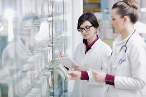 Team of pharmacist chemist woman in pharmacy drugstore