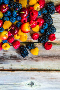 Mix Of Berries On Wooden Background
