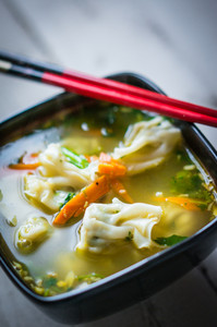 Wonton Soup On Wooden Background