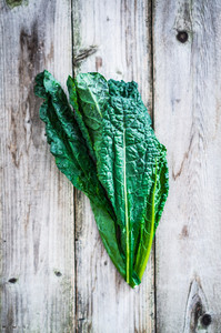 Kale On Wooden Background