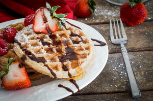 Waffles With Strawberries On Wooden Background