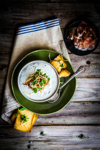 Cream Soup With Bread And Meat On Wooden Background