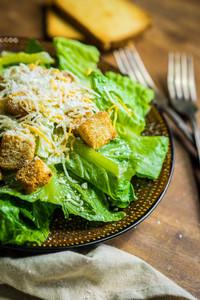 Caesar Salad On Rustic Background