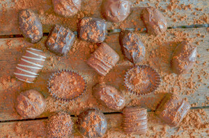 Assorted Chocolate Pralines On Brown Background