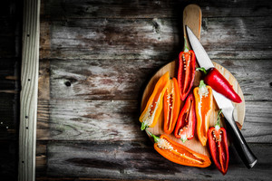Colorful Peppers On Rustic Background