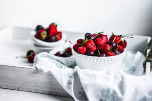 Mix Of Berries On White Rustic Background
