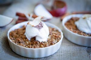 Apple Crumble Dessert With Cinnamon And Vanilla Ice Cream On Wooden Background