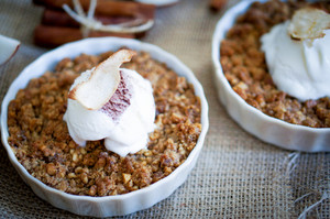 Apple Crumble Dessert With Cinnamon And Vanilla Ice Cream On Wooden Background