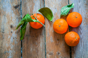 Fresh Tangerines On Wooden Background