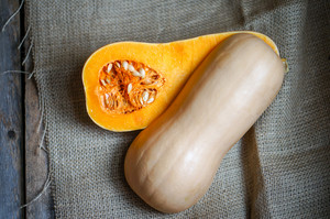 Uncooked Sliced Butternut Squash On Wooden Background
