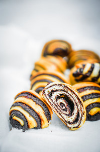 Poppy Seed Rolls On White Background
