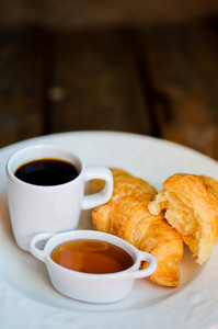 Tasty Breakfast:coffee With Croissants And Jam On Wooden Background