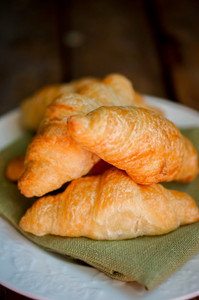 Fresh Croissant On Wooden Background
