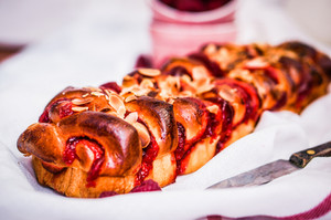 Raspberry Cake With Almonds On Wooden Background