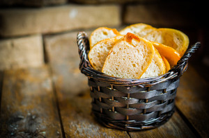 Sliced Fresh Bread On Wooden Background