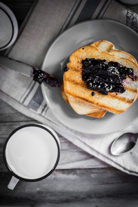 Toasted Bread With Jam And Milk On Wooden Background