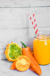 Orange Smoothie On Rustic Background
