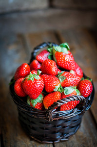 Basket Of Fresh Strawberries On Wooden Background