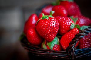Basket Of Fresh Strawberries On Wooden Background