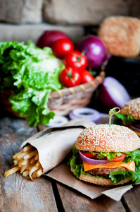 Closeup Of Home Made Burgers On Wooden Background