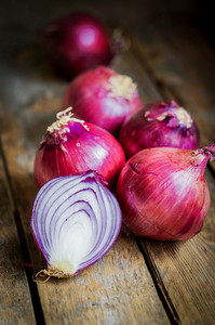 Red Onions On Rustic Wooden Background