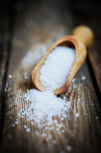 Closeup Of Sea Salt On Rustic Wooden Background