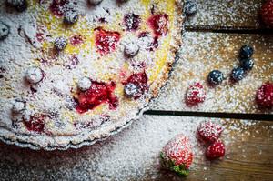 Berry Tart On Wooden Table