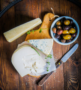 Assorted Cheese On Wooden Background