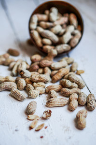 Roasted Peanuts On White Wooden Background