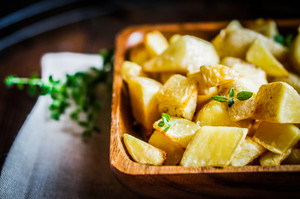 Baked Potatoes On Wooden Background