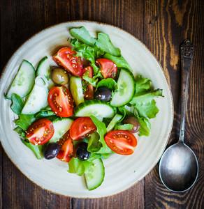 Vegetable Salad On Wooden Background