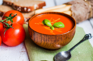 Tomatoe Soup With Bread Sticks And Basil On Wooden Background