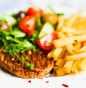 Steak With French Fries And Salad