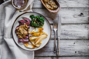 Steak With Baked Botatoes And Green Salad On Wooden Background