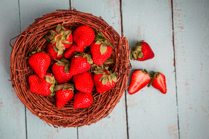 Strawberries In The Basket On Wooden Background