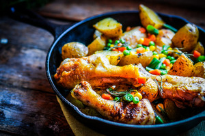 Oven Baked Chicken With Potatoes And Vegetables On Wooden Background