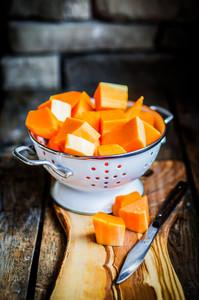 Fresh Cut Pumpkin On Rustic Wooden Background