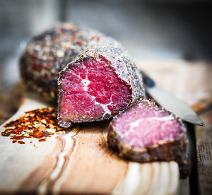 Dried Meat With Pepper And Salt On Rustic Wooden Background