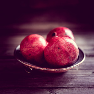 Pomegranate On Wooden Background