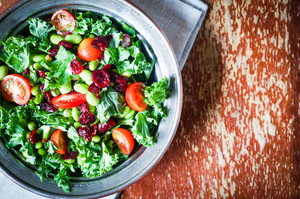 Kale And Edamame Salad On Rustic Background