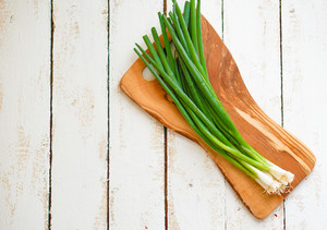 Farm Raised Organic Green Onions On Wooden Background
