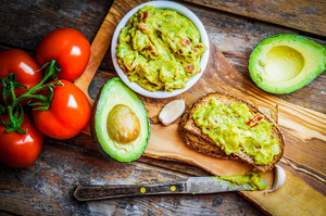 Guacamaole With Bread And Avocado On Rustic Wooden Background