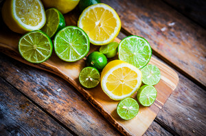 Lemons And Limes On Rustic Wooden Background