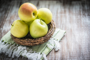 Apples In A Basket On Rustic Background