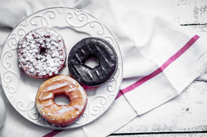 Assorted Donuts On Rustic Wooden Background