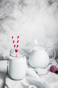 Milk Jar On Wooden Rustic Background