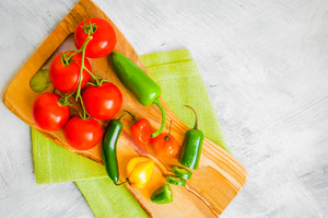 Assorted Pepper And Tomatoes On Wooden Background