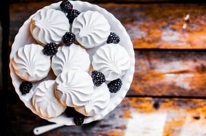 Meringue Cookies Witj Blackberries On Rustic Background